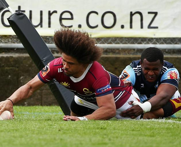 Isaac Te Tamaki, of Southland, crosses the tryline in the tackle of Jone Macilai, of Northland,...