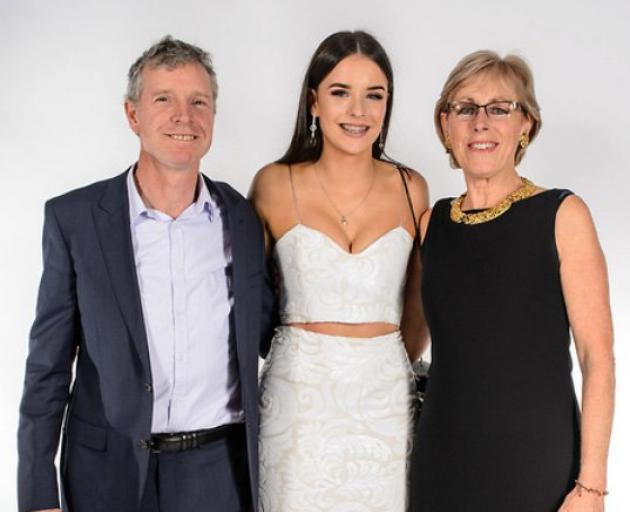 Sophia Crestani with her parents, Bede Crestani and Elspeth McMillan, ahead of her year 13 ball....