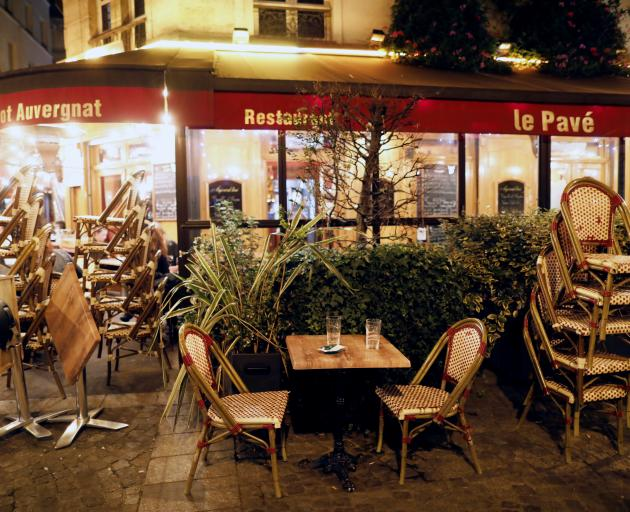 A restaurant in Paris prepares to close minutes before the late-night curfew begins. Photo: Reuters