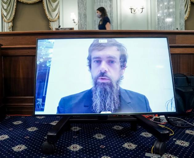 Twitter chief executive Jack Dorsey gives his opening statement remotely during the hearing held...