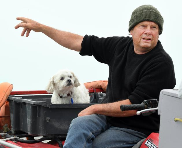 Veteran whitebaiter Barry Fraser and his dog Peanut at the Waitaki River mouth.