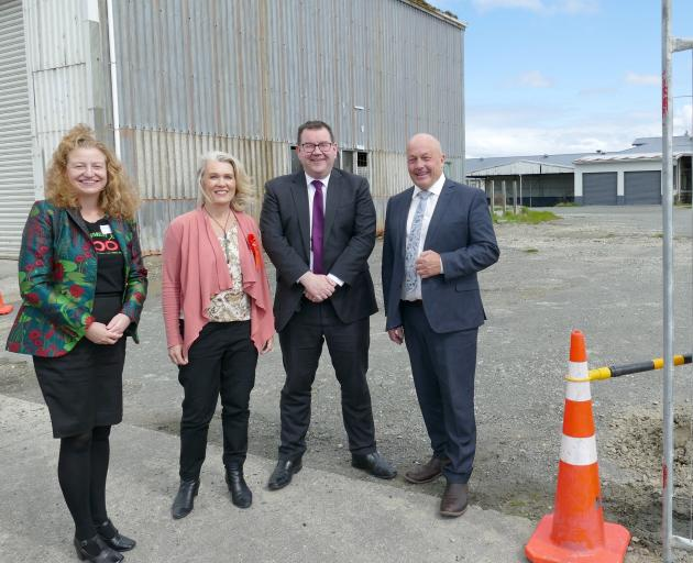 Finance Minister Grant Robertson pauses in Balclutha with (from left) Labour list candidate...