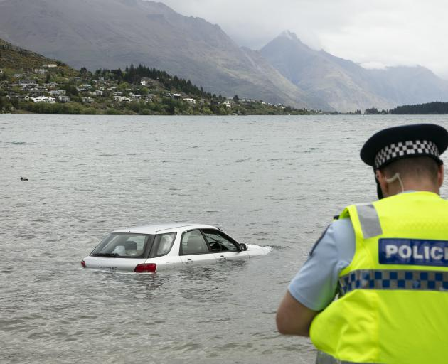 Police at Lake Wakatipu where a car was driven into the water. Photo: Supplied