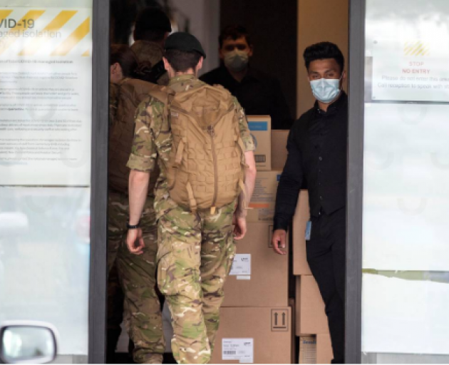 Military personnel enter the Sudima Hotel in Christchurch. Photo: NZH