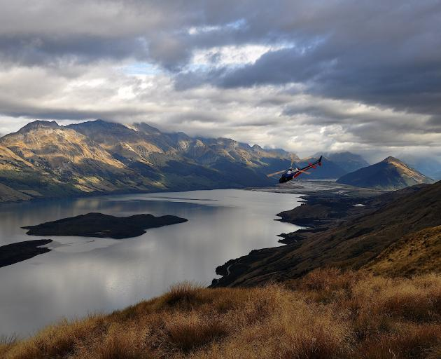 Hamish McKerchar pilots a helicopter over Queenstown and Milford. PHOTO: SUPPLIED