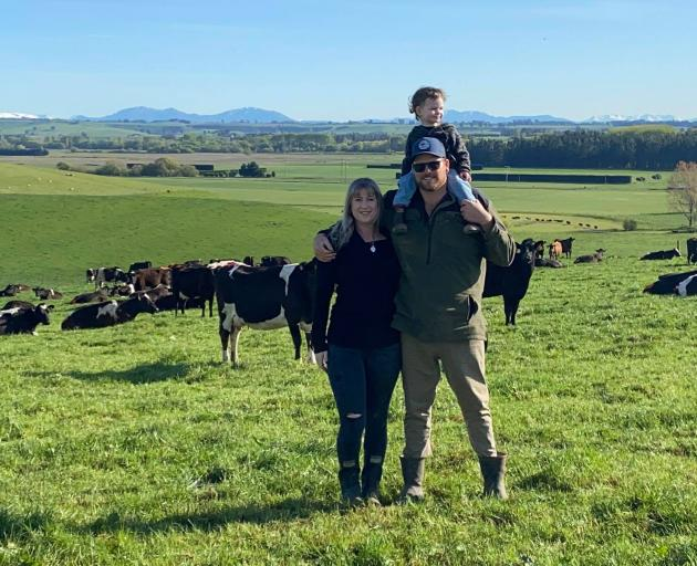 Alex Pattullo (right), Danielle and son Charlie (20 months) try to get out on the farm together...