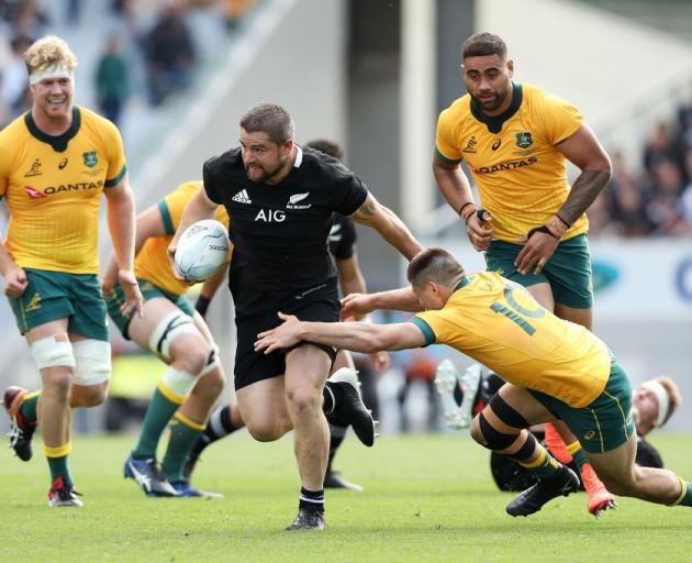 Dane Coles tries to evade the tackle of James O'Connor during the second Bledisloe Cup test....