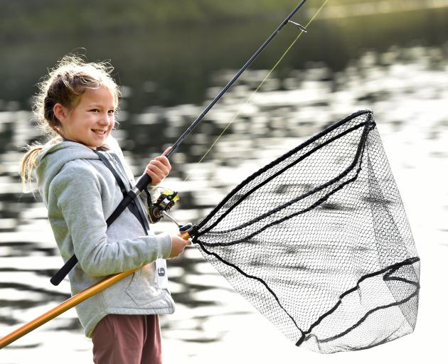 Ada Silva (9) prepares to haul in a rainbow trout during the annual Otago Fish & Game Take a Kid...