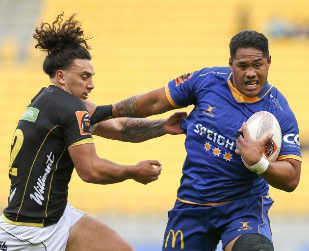 Otago's Sione Misiloi fends off Peter Umaga-Jensen during Otago's late win over Wellington. Photo...
