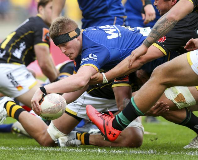 Otago lock Jack Regan scores a try during his team's round five Mitre 10 Cup match against...