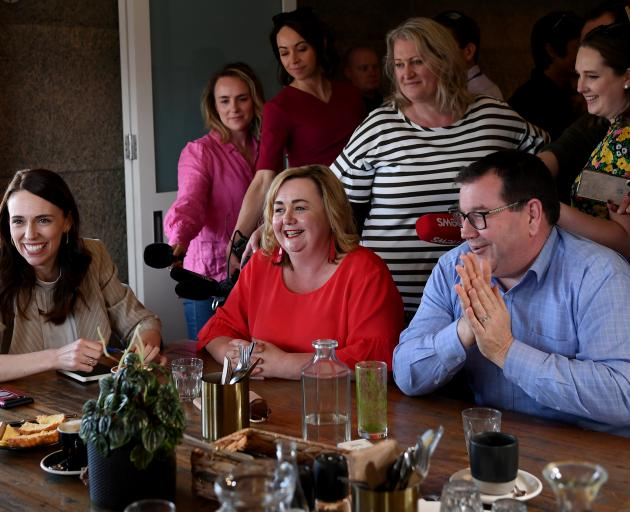 Prime Minister Jacinda Ardern meets returned MPs Megan Woods and Grant Robertson at a cafe in...