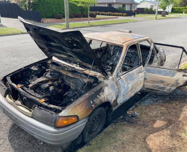 James Withington's car was pushed along the street and set alight. Photo: Supplied