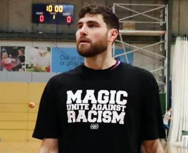 Magic player Sam Timmins with the T-shirt the Magic Lions side wore last weekend in the warm-up...