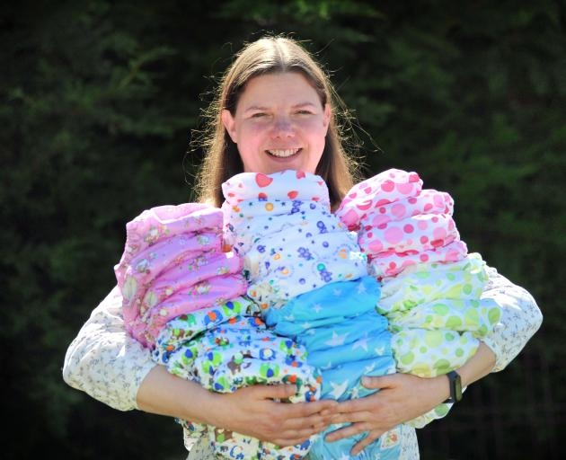 Kelly Sweeney with some of the nappies her now 10-year-old business sells from Sawyers Bay in...