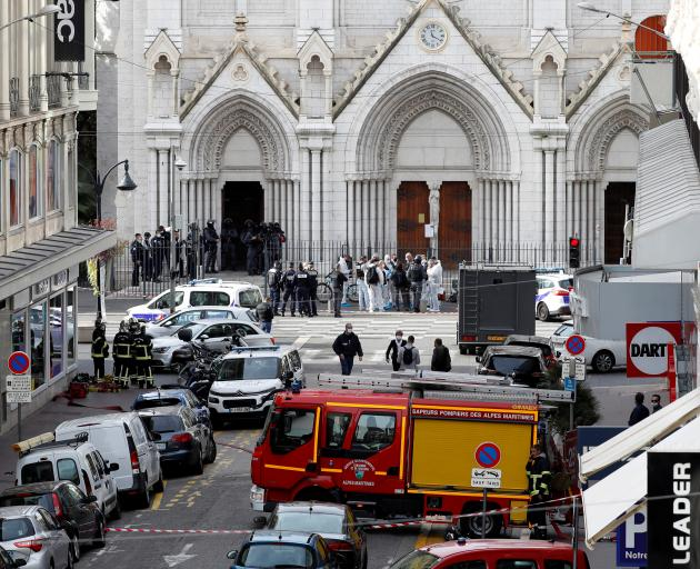 Security forces guard the area after a reported knife attack at Notre Dame church in Nice, France...