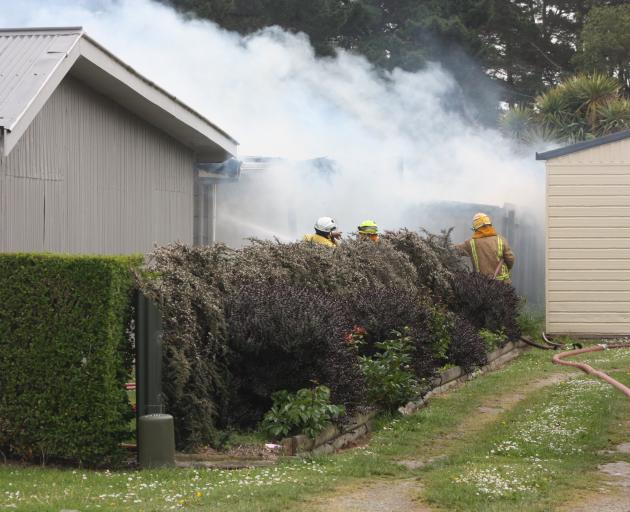 Firefighters battle the blaze in Kakanui Rd yesterday. PHOTO: GUS PATTERSON