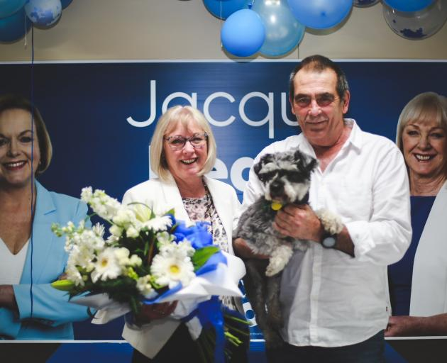 Returning Waitaki MP Jacqui Dean celebrates her win with husband Bill and Jimmy the dog in Oamaru...