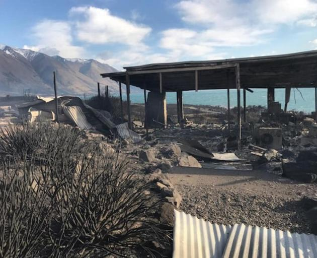 The fire-ravaged remains of a house near the shore of Lake Ohau. PHOTO: SUPPLIED