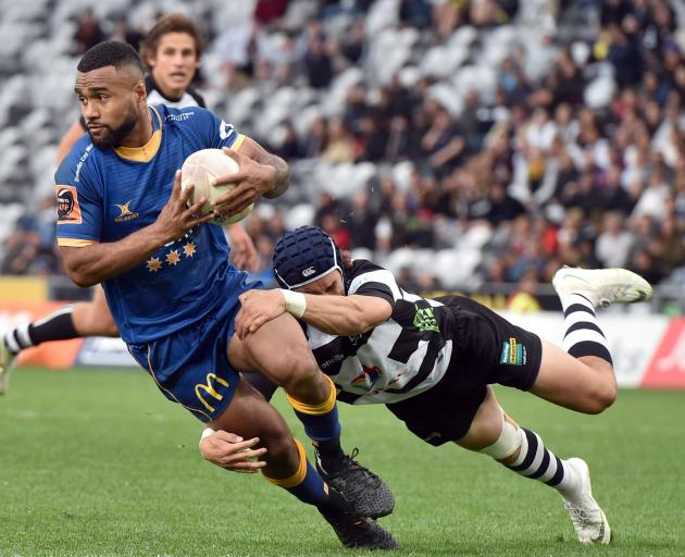 Otago winger Joan Nareki is tackled by Hawke's Bay replacement back Caleb Makene during the...