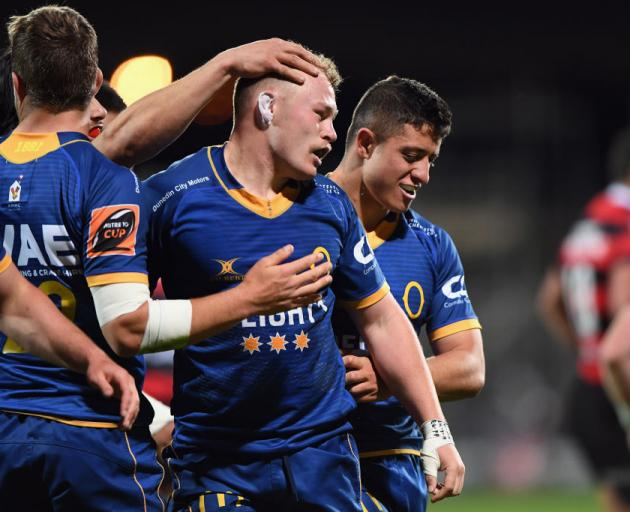 Slade McDowall (centre) celebrates with his Otago teammates after their win against Canterbury tonight. Photo: Getty Images