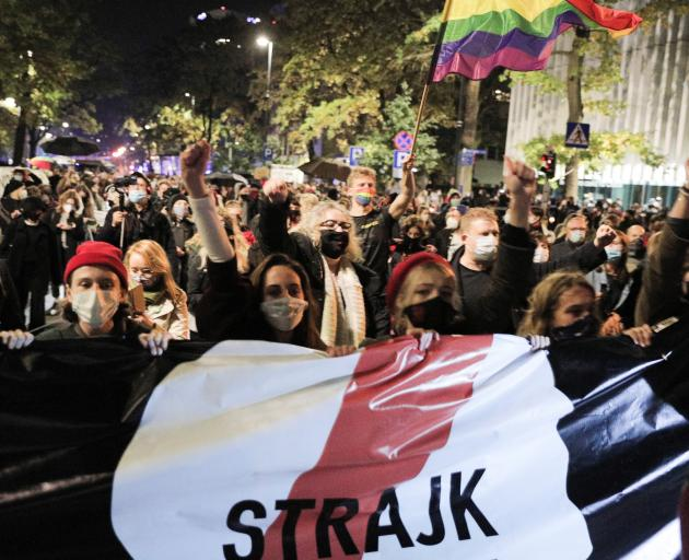 People protest against imposing further restrictions on abortion law in Poland in front of the Constitutional Court building in Warsaw. Photo: Reuters