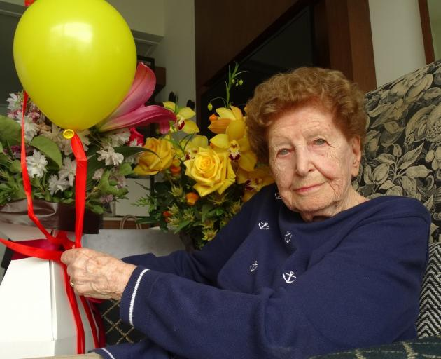 Luce Wilsens enjoys her flowers from Kamana Lakehouse staff. PHOTO: GUY WILLIAMS