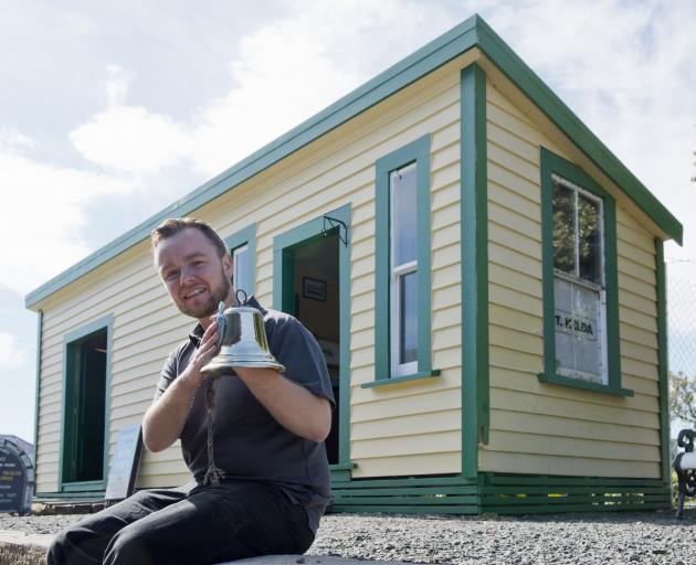 Ocean Beach Railway operations manager Philip Riley polishes a bell outside the newly renovated...