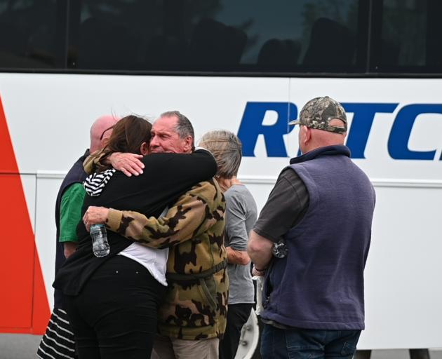 Residents return from a tour of the fire devastated Lake Ohau village. Photo: Craig Baxter