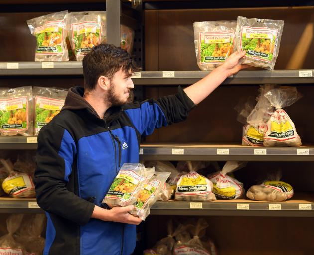 Nichol's Garden Centre staff member Adam Jamieson sorts the dwindling supply of seed potatoes in...