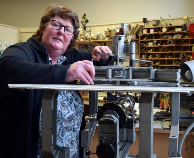 John Swan and Co Ltd owner Janette Armstrong engraves a trophy in her small business in central...