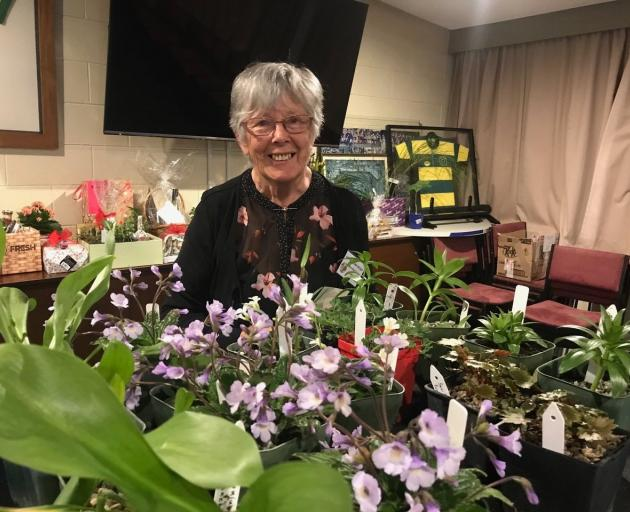 Marcelle Garden, of Roxburgh, behind her well-stocked sales table at the New Zealand Trillium...