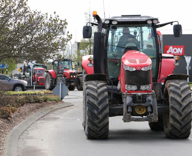 Waikaka farmer Laurie Paterson leads the parade of tractors down  Gore's Main St today. Photo: Sandy Eggleston