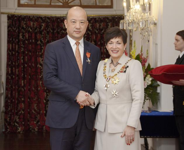 Zhang Yikun with Governor-General of New Zealand Patsy Reddy after receiving an Order of Merit...