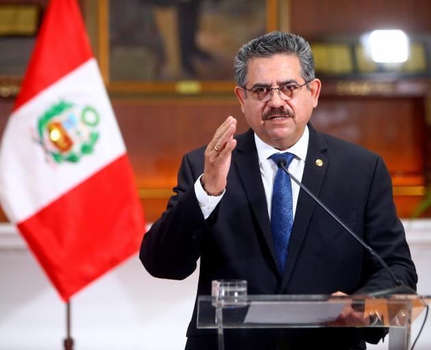 Peru's interim President Manuel Merino announces his resignation in a televised address. Photo: Peruvian Presidency/Handout via Reuters