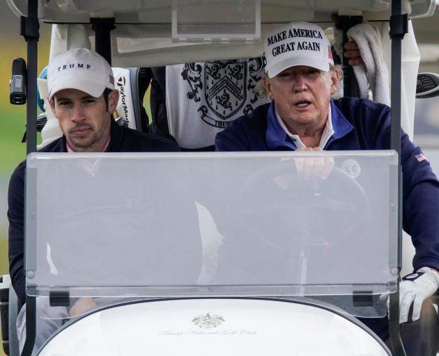 President Donald Trump took to his golf course in Sterling, Virginia at the weekend. Photo: Reuters