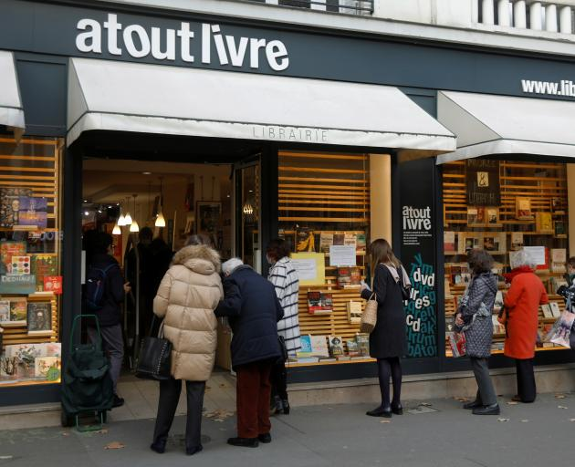 People queue at the 'click and collect' service of a Paris bookshop. Photo: Reuters