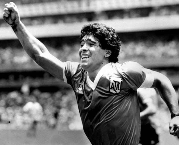 Maradona celebrates after scoring his game winning goal against England in their World Cup...