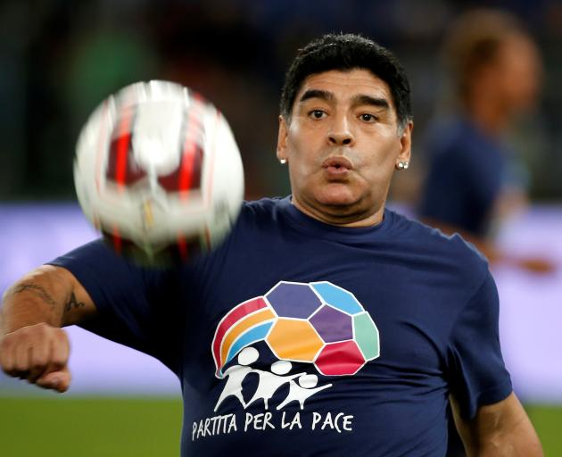 "Diego Maradona warms up before the start of a special interreligious ""Match for Peace"" at the..."