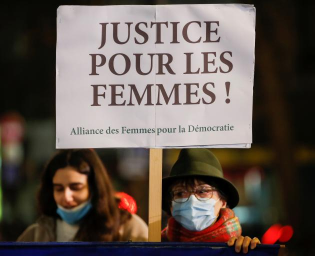 Women attend a gathering to protest femicides and violence against women in Paris. Photo: Reuters