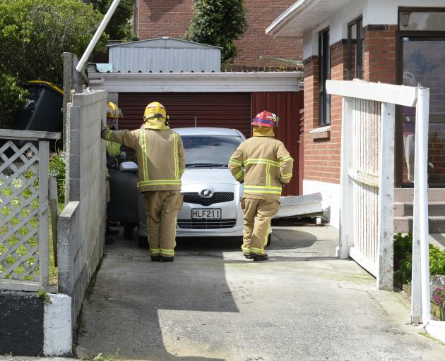 Firefighters in Gloucester St, Andersons Bay, Dunedin, after high winds blew the roof off this...