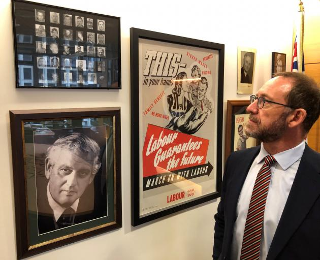 Minister Responsible for Pike River Re-entry Andrew Little with a picture of the Pike 29. PHOTO:...