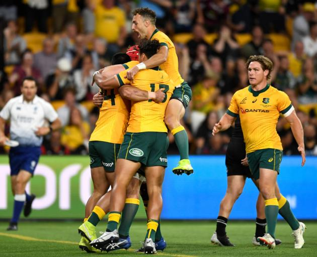 Wallabies players celebrate a Tom Wright try during the 2020 Tri-Nations match against the All Blacks. Photo: Getty Images