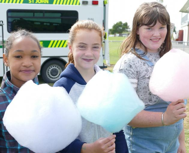 Testing all the candy floss flavours are (from left) Aidan Cloete and Elah Cain (both 10), and...