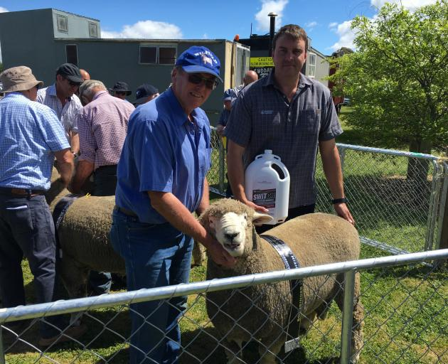 West Melton farmer Robin Wilson is congratulated by the sponsor, Boehringer territory manager...