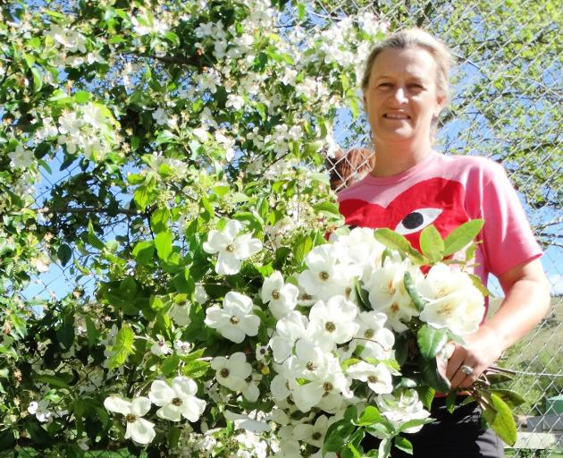 Anna Mackay with dogwood, rhododendron and crab apple flowers. PHOTOS: MARK PRICE