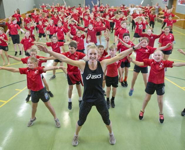Fairfield School pupils play a game of Simon Says with Silver Fern netballer Shannon Saunders, as...