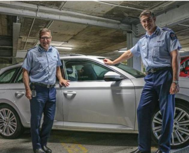 Police Commissioner Andrew Coster (right) and Deputy Commissioner Jevon McSkimming with one of the new Skoda vehicles. Photo / Police