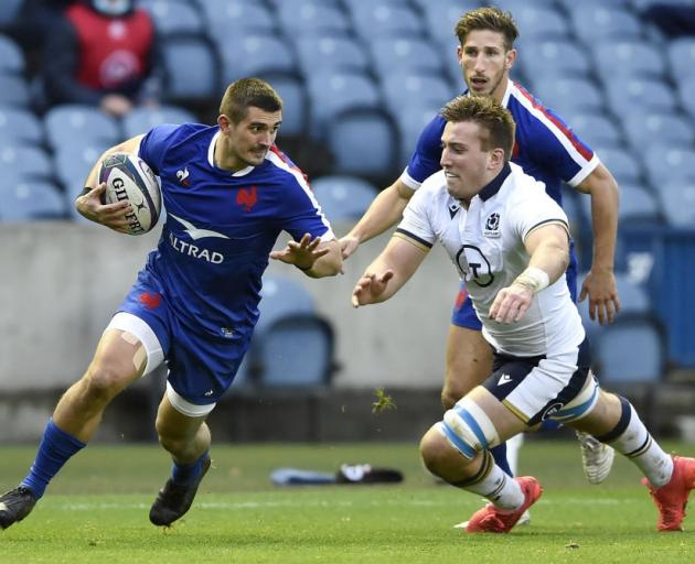 France's Thomas Ramos (left) and Scotland's Matt Fagerson in action during the Autumn Nations Cup...