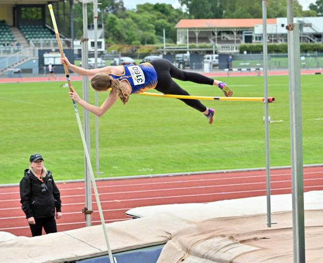 Taieri athlete Gabi Horo (16) nudges the bar during the pole vault at an Athletics Otago meeting...