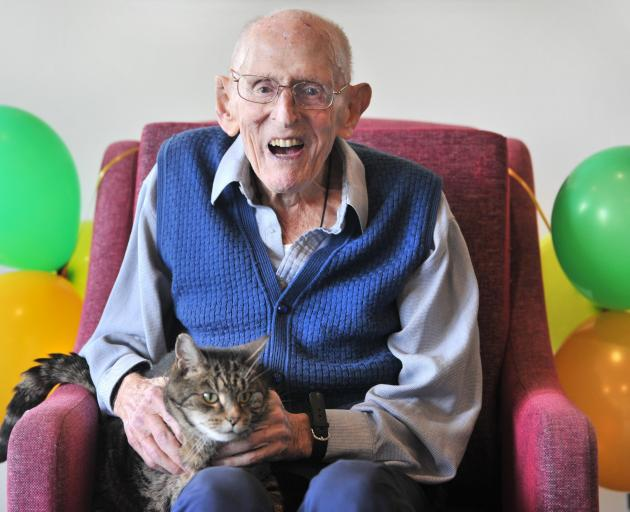 Gerald Huntley, along with resident cat Missy, celebrates his birthday with a barbecue lunch at...